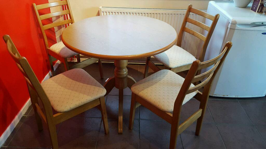 Solid wood table4 Chairsin Wirral, MerseysideGumtree - Lovely solid table with 4 Chairs, comfortably seats 4 adults. Top can be removed for transport. Will deliver for a fee depending on location
