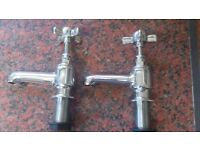 Two 22 mm bath taps