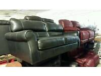 Black leather 2 x 2 seater sofa bed