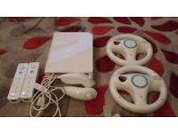 Nintendo Wii with controls and Super Mario Kart game. In very good condition