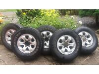 Set of 5 alloy wheels with excellent quality All Terrain tyres - from Mitsubishi