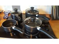 4 Tefal pans and 2 Tefal frying pans