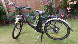 Electric bike with new battery fitted , comes with charger , and ready to go