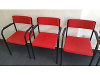 Red stackable meeting / reception office chairs + a black one