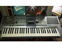 Yamaha PSR E403 61 key electronic keyboard plus stand, adaptor, manual and books
