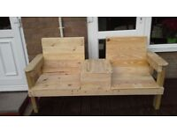 A double wooden bench seat