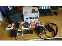 Canon EOS M 18MP mirrorless camera. Fully working & with lots of accessories. Ready to go