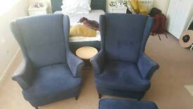 Pair of Ikea strandmon wing back chairs and footstool
