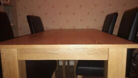 Dining room table and 6 faux leather chairs