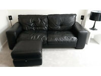 Black leather sofa & footstool (with storage)