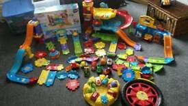 Vtech toot toot garage with over 14 cars.
