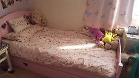Girls single bed with mattress and large storage draw. In great condition.