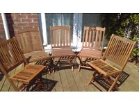 Garden chairs TEAK HARD WOOD , Good, used condition and stored away in Winter. 5 in total( 3 and 2).