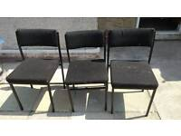 Three black, metal, chairs.