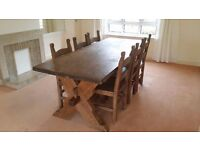 2. 3m long hand made wooden dining table and 6 chairs