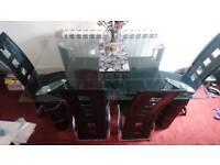 6 seat glass dinning table and 4 chairs