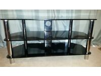 Black glass TV stand for sale in excellent condition