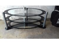 Oval black/clear glass entertainment stand