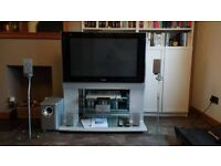 Panasonic TV on stand, with DVD Home Theatre Sound System