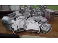 For sale 20 different shaped Wilton character cake tins