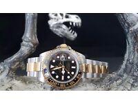 Black faced Rolex Daytona with black ceramic bezel & twotone bracelet. Comes in Rolex box& bag