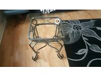 Glass coffee table with iron frame