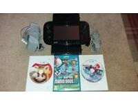 NINTENDO WII U 32 gb in black with 3 games including mario kart 8