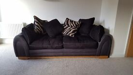 Two black sofas and footstool in great condition