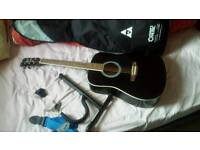 Acustic guitar + accessories