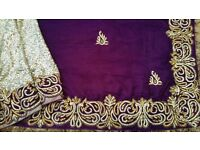A selection of Indian sarees in purple (£170), cerise (£170), coral (£125) and pink (£100). Ovno.