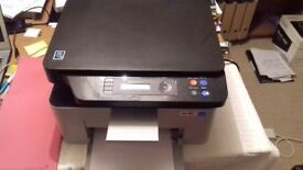 SAMSUNG Xpress M2070W Wireless All-In-One Laser Printer. Less than one year old.