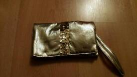 Ladies small gold clutch bag