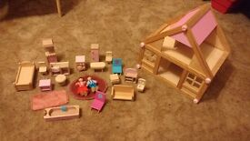 Dolls house with two people and lots of furniture