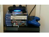 PS4 WITH 2 CONTROLLERS 7 GAMES INC FIFA 17 COD INFINITE WARFARE