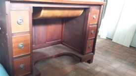 Sewing machine table with accessories drawers.