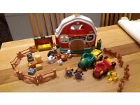 Assorted pre-school toys including farm, mega blocks fire engine and push along dog