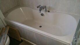 Bathtub, toilet, handbasin and shower screen.