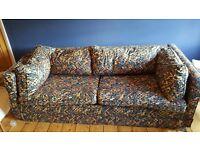 Huge multi-coloured sofa bed