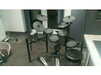 Electronic drumkit with stool and drumsticks