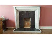 Complete fireplace, hearth, backplate & mantlepiece. Will suit gas or electric fire -not included.