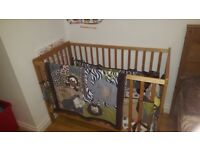 Baby cot with bedding set