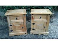 A pair of pine bed side tables