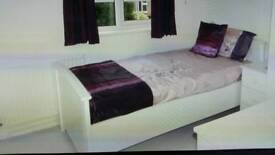 3.0 white single bed with mattress.