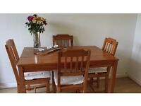 4ft pine table and 4 chairs with cushions