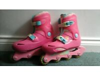 Slightly worn size 2.5 roller skates