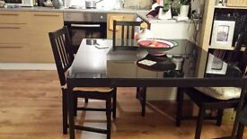 Near brand dining table and 4 chairs for sale £80.