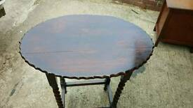 Vintage Dark solid wood table with barley twist legs and in good condition