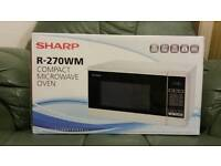 Brand New,Unopened Sharp Microwave oven