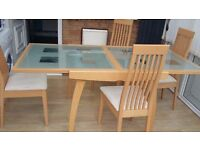Extendable pine and glass dining table and 4 cream chairs