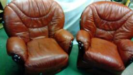Two real leather armchairs